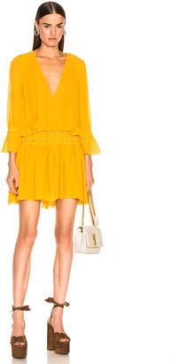 Saint Laurent Long Sleeve Mini Dress in Mimosa | FWRD