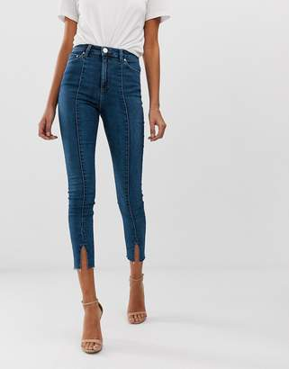 Asos Design DESIGN Ridley high waisted skinny jeans in mid wash blue with front seam and vent hem detail