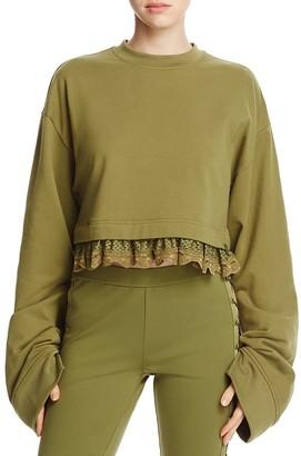 FENTY Puma x Rihanna Lace-Trimmed Crop Sweatshirt $150 thestylecure.com