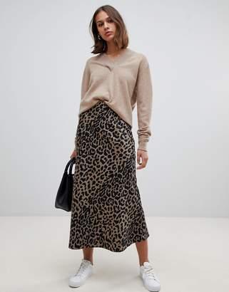 Asos DESIGN bias cut satin midi skirt in leopard print