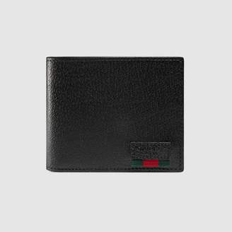 Gucci Leather bi-fold wallet with Web