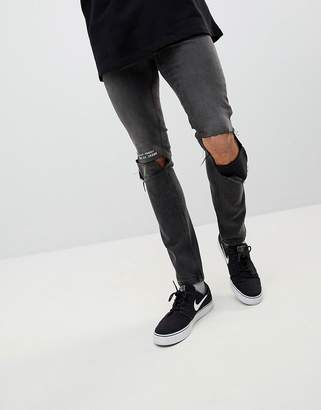 Cheap Monday Tight Skinny Ripped Jeans with Error Message