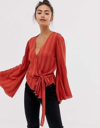 Asos Design DESIGN long sleeve wrap top in crinkle
