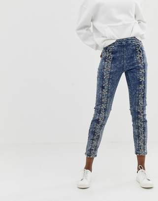 Asos Design DESIGN Farleigh high waisted slim mom jeans in acid wash with lace up front detail