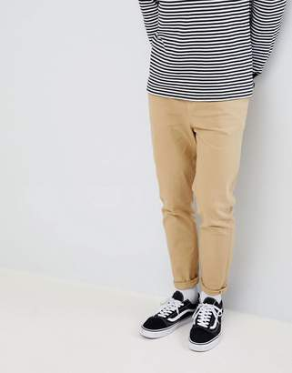 Asos DESIGN tapered jeans in stone