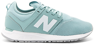 New Balance 247 Sneaker in Turquoise $80 thestylecure.com