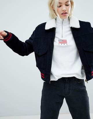 Asos DESIGN cord jacket in navy with tipping