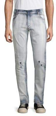 Balmain Distressed Light Wash Tapered Jeans
