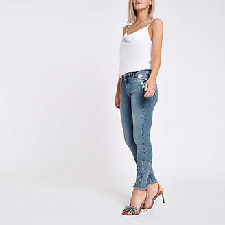 River Island Petite blue mid rise studded Amelie jeans