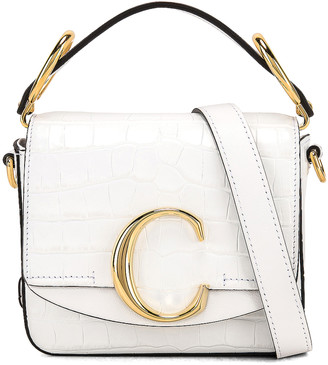 Chloé Mini C Embossed Croc Crossbody Bag in Brilliant White | FWRD