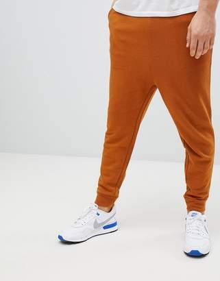 Asos DESIGN drop crotch joggers in rust