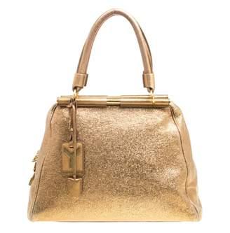 Saint Laurent Gold Leather Handbags