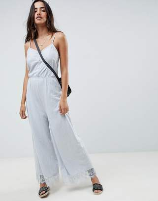 Asos DESIGN cami jersey jumpsuit with lace trim and button front