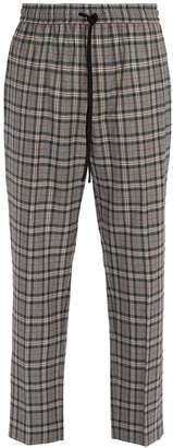 Gucci Mid-rise check wool trousers