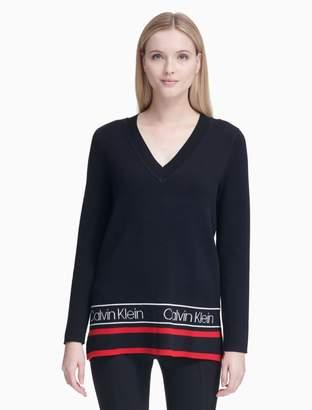 Calvin Klein v-neck varsity logo hem long sleeve top