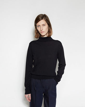 Margaret Howell Buttoned Roll Neck Sweater $460 thestylecure.com
