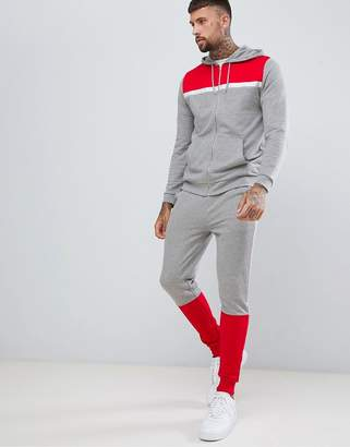 Asos DESIGN tracksuit zip up hoodie/ skinny joggers with color blocking
