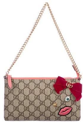 Gucci GG Supreme Embroidered Face Chain Wrist Wallet