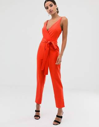 Asos Design DESIGN wrap front jumpsuit with peg leg and self belt
