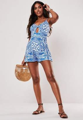 53adfa7b2de9 Free Shipping at Missguided · Missguided Blue Printed Cut Out Playsuit