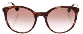Prada Round Tortoiseshell Sunglasses