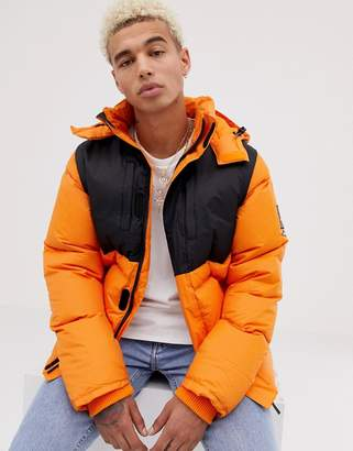 Helly Hansen Sweet Sktbs SWEET SKTBS X Two in One Padded Jacket in Orange