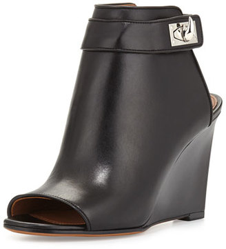 Givenchy Shark-Lock Wedge Bootie, Black $1,450 thestylecure.com
