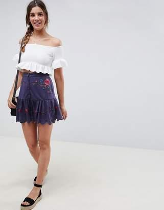 Asos DESIGN button front embroidered pep hem mini skirt