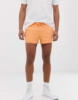 Asos Design DESIGN jersey runner shorts in orange
