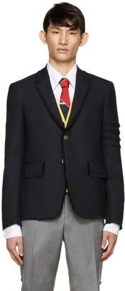 Thom Browne Navy Wool Frayed Armband Blazer $3,200 thestylecure.com