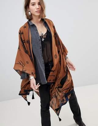 Asos Design DESIGN western kimono cape with tassels