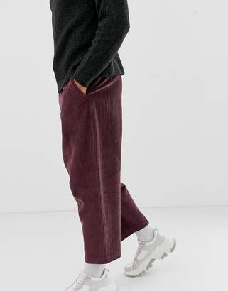 Asos DESIGN drop crotch tapered pants with cargo pocket in purple cord