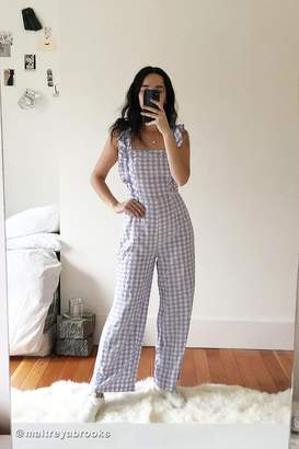070085450fb Urban Outfitters Emerson Gingham Ruffle Jumpsuit