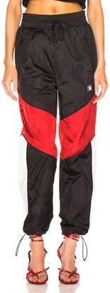Alexander Wang Windbreaker Track Pant in Black, White & Red | FWRD