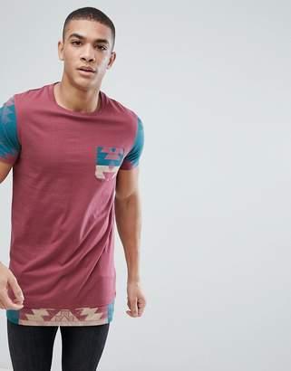Asos DESIGN t-shirt with geo-tribal printed sleeves & pocket & hem extender