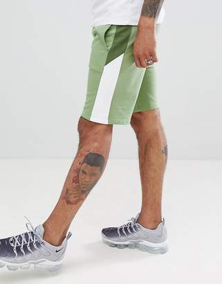 Asos DESIGN jersey skinny shorts with color blocking side stripe