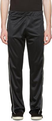 Maison Margiela Black Snap Track Pants $975 thestylecure.com