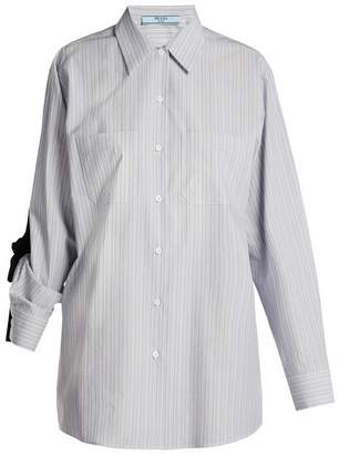 Prada Bow-embellished striped cotton shirt