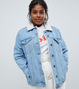 Asos DESIGN Curve denim jacket with borg collar in midwash blue