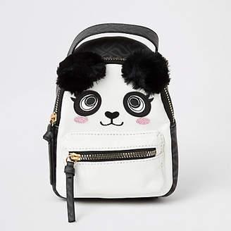 River Island Black panda faux fur pom pom mini backpack
