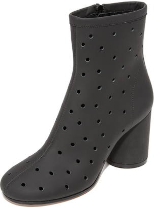 Maison Margiela Perforated Ankle Booties $985 thestylecure.com