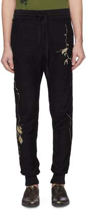 Haider Ackermann Floral embroidered outseam jogging pants