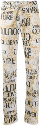 Versace baroque logo distressed jeans