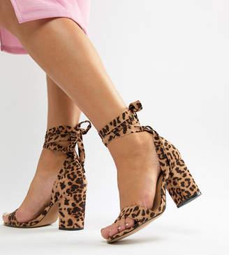 Asos DESIGN Wide Fit Howling tie leg block heeled sandals in leopard print