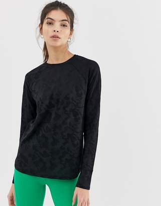 Asos 4505 4505 long sleeve top in sheer camo and loose fit