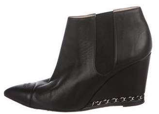 Chanel Cap-Toe Wedge Booties