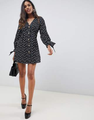 Asos Design DESIGN button through mini skater dress with tie sleeves in spot