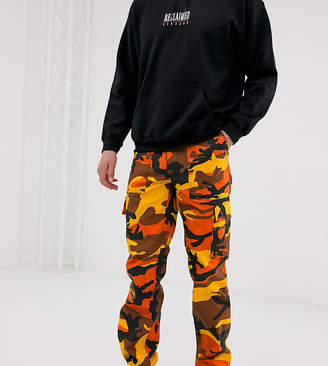 Reclaimed Vintage Revived camo cargo pants in orange