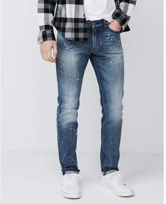 Express skinny medium wash destroyed stretch jeans