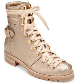 Christian Louboutin Who Runs Gold Leather Boots